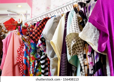 Clothes of different colors on vintage metal hanger