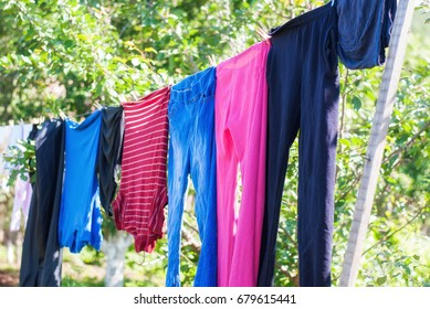 Clothes dry on a rope