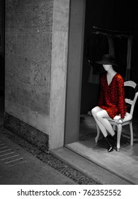 Clothes dummy in a shop window. Photo taken at night time in Verona, Italy
