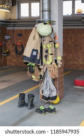 Clothes of a firefighter hanging from a pillar