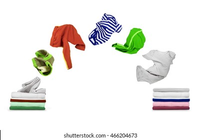 clothes fly out of pile and fall on pile isolated on white backgroun
