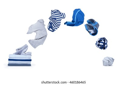 clothes fly out of pile and falls down isolated on white background