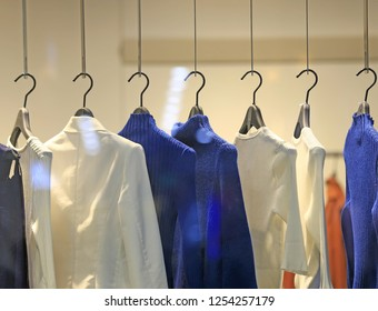 Clothes hang on hangers