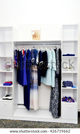 Clothes hang on a shelf in a designer clothes store. Clothing store for  women. ecfa708187c