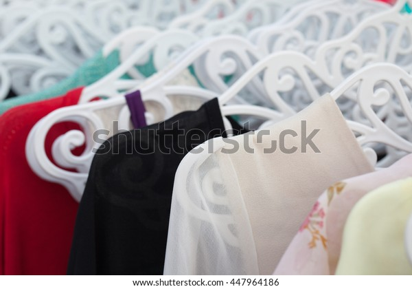 Clothes hang on a shelf in a clothes store