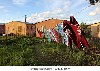 Clothes hang on a washing line and dry in the afternoon sun in a rural township setting in South Africa.