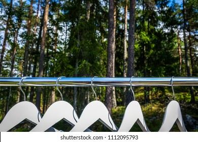 Clothes hanger / closet in the woods / forest. Concept for organic clothes, eco-friendly, ecological fashion.