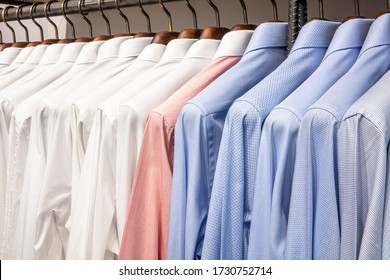 The clothes hanger is Filled with colorful Fabric shirts. Shop of men's shirts.