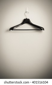 clothes hanger on wall, monochrome (in fitting room)