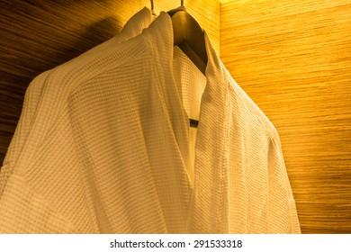 clothes hanger in wooden wardrobe