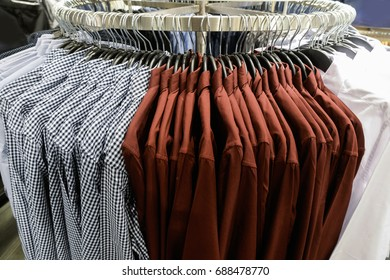 Clothes hangers in fashion store.