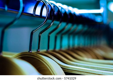 Clothes hangers in fashion store. Clothes business concept