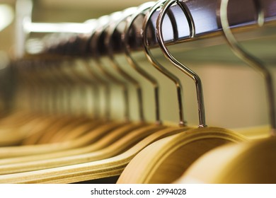 Clothes hangers in the fashion store.  Clothes store concept