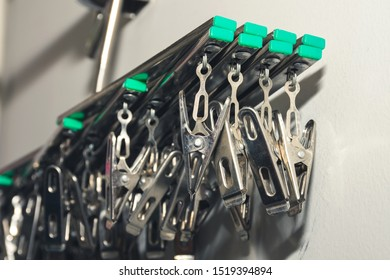 Clothes hangers and stainless steel with clips hanging on clothes rack in condominium or apartment Balcony.