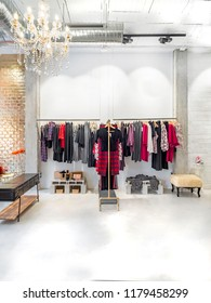 Clothes hanging from modern estructures. Fashion store interior business