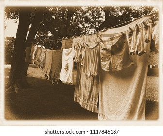 Clothes hanging on the clothesline with sepia treatment