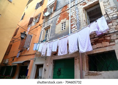 Clothes hanging on the facades of historical buildings of Rovinj, Croatia