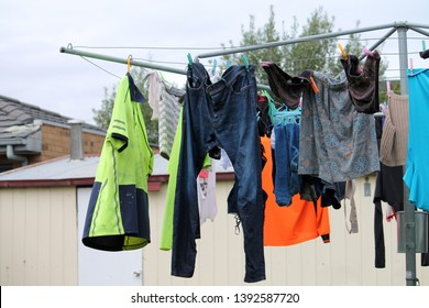 Clothes hanging on the line in the sun.