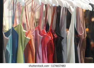 Clothes hanging on a clothes rack.