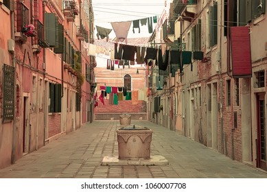 Clothes hanging on a rope on a traditional Venetian street