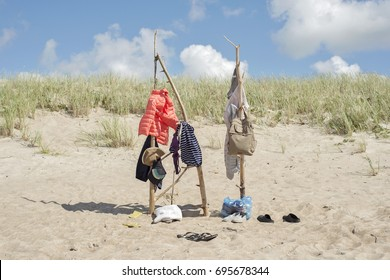7f5a52209c2 clothes hanging on the wooden poles at the beach