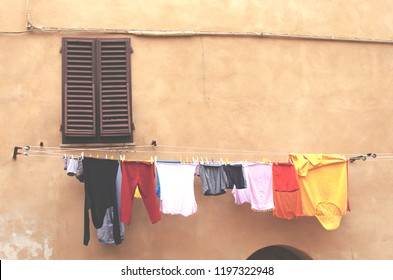clothes hanging and window in an old street of mediterranean city in europe