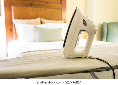 Clothes iron and ironing board in a hotel room