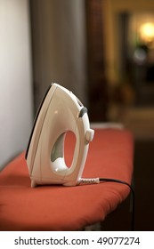Clothes iron on ironing board