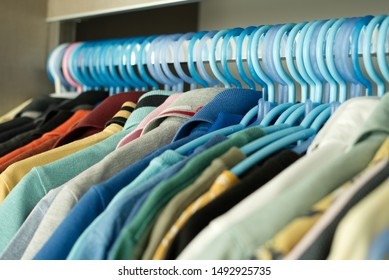 Clothes line in the closet with colorful Shirt with collar