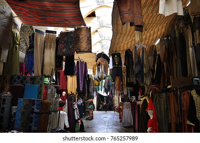 a clothes market in a traditional old souk in Tripoli, Lebanon.