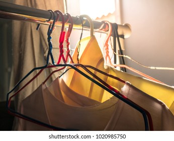 Clothes and old cheap hangers On the rack.