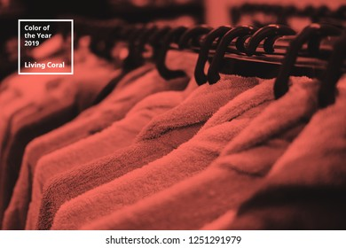 Clothes on hanger. Color of the year 2019 Living Coral. Popular trend palette for design illustrations, fabrics, fashion, images. Tinted background