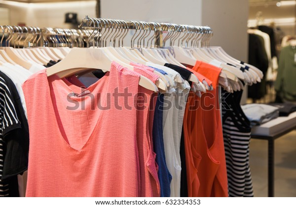 Clothes on hanger at shopping mall. Sale concept.