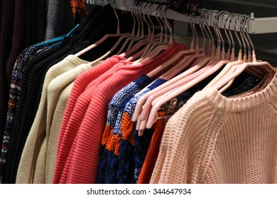 Clothes on hangers in the fashion store.