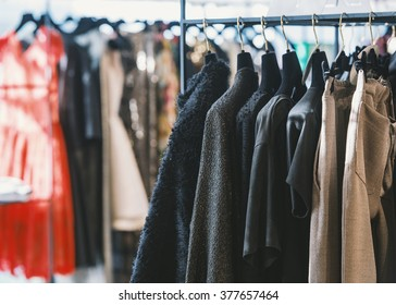 Clothes on hangers in a retail shop.