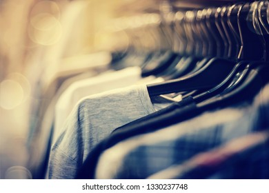 Clothes on hangers in shop for sale