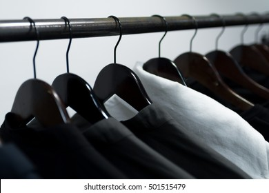 Clothes on hangers in store