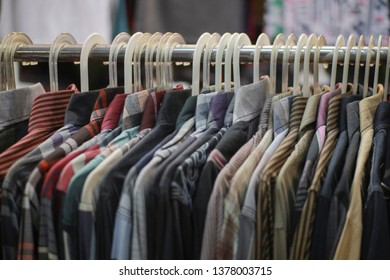 Clothes on hangers in the Traditional Fashion Retail Market in Yogyakarta, Indonesia