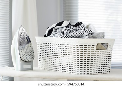 ?roning clothes on ironing board