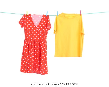 Clothes on laundry line against white background