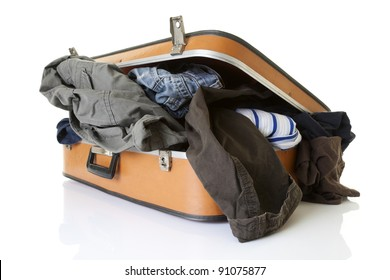Clothes on old fashioned suitcase