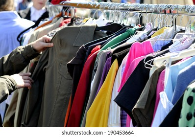 clothes on a rack in a flea market