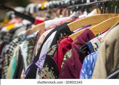 clothes on a rack on a flea market.