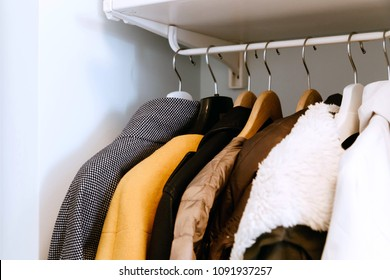 Clothes on the rail in the wardrobe. Minimalism, declutter your home