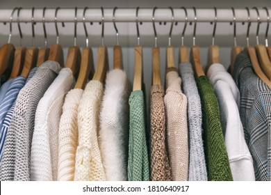 Clothes on a rail in a wardrobe. Seasonal capsule for easy dressing, order in things, cleaning out