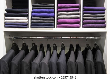 Clothes on the shelves in the store