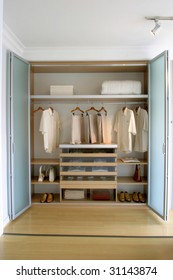 clothes organized in closet