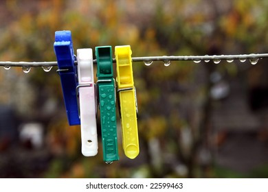 Clothes pin on a line after rain