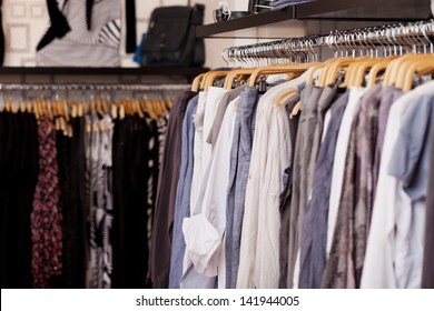 Clothes rack full of clothes in clothing store