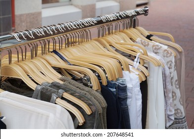 clothes rack with a selection of ladies fashion